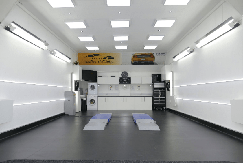 Photo of a well-lit car detailing studio