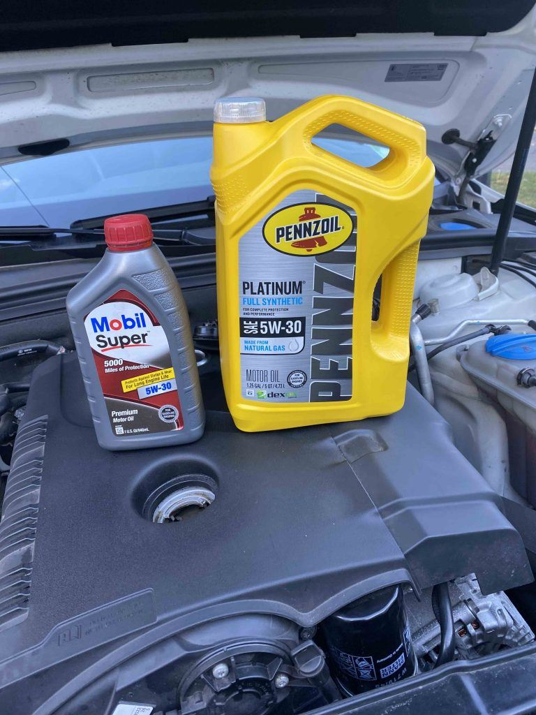 Penzoil platinim synthetic and Mobil super conventional under the hood of my Audi Allroad