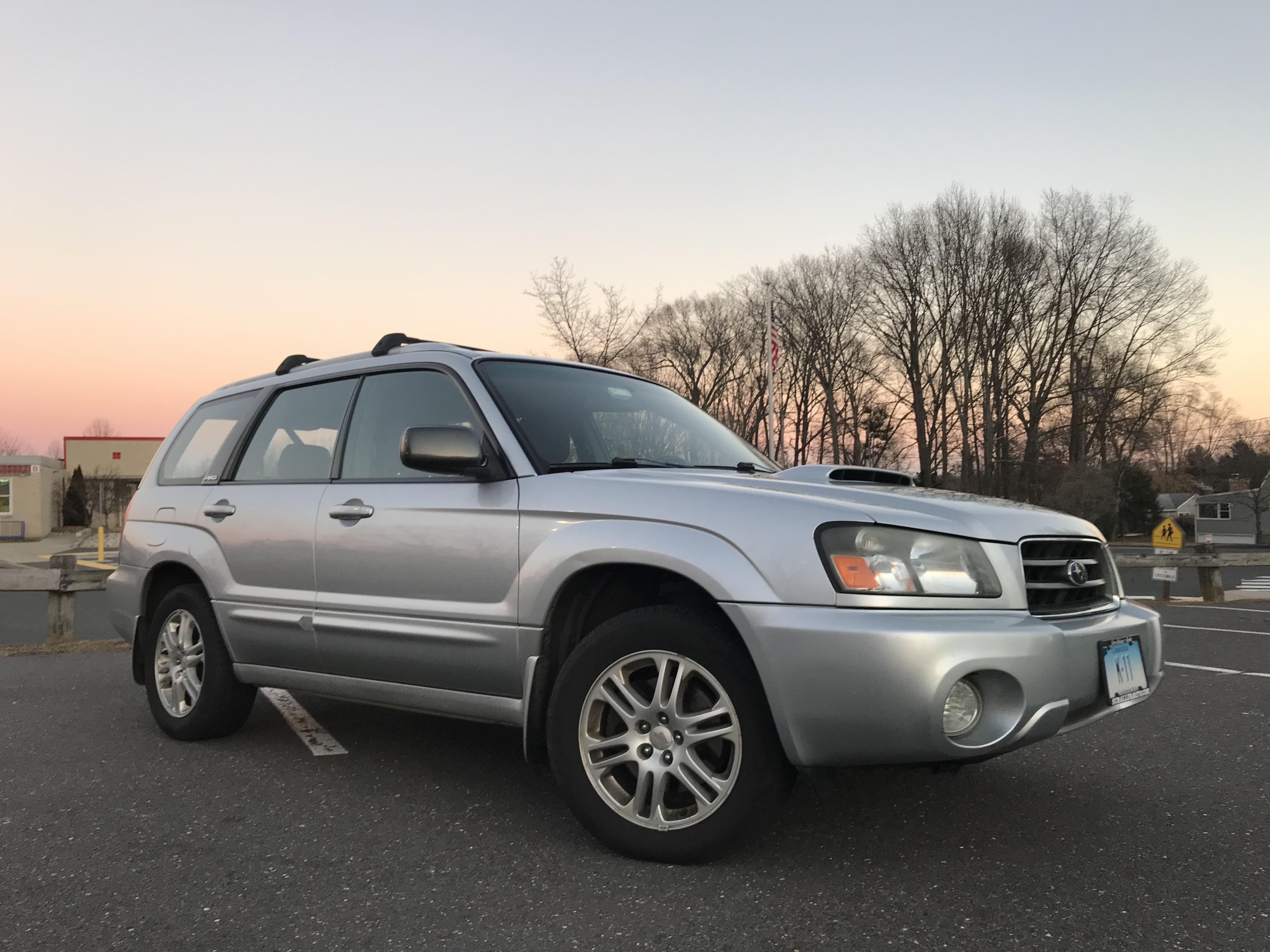 Picture of the front of a silver 2003 Subaru Forester XT