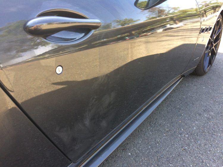 Photo showing ceramic coating gone wrong on a Maserati door.