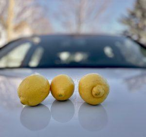 Picture of lemons on the hood of a white car