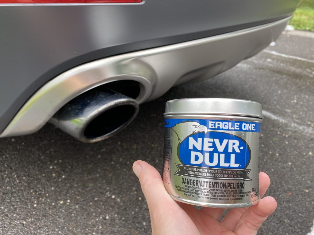 Photo of Never Dull next to exhaust tips