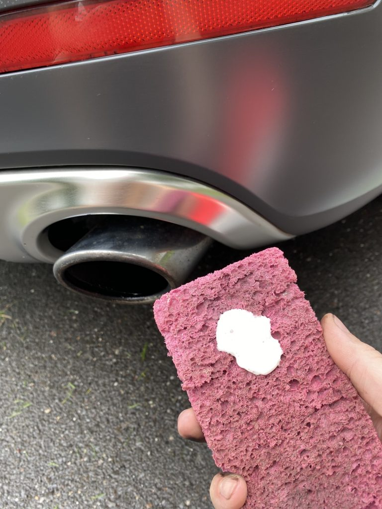 Photo of Soft Scrub being applied to exhaust tips